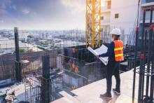 Smart civil architect engineer inspecting and working